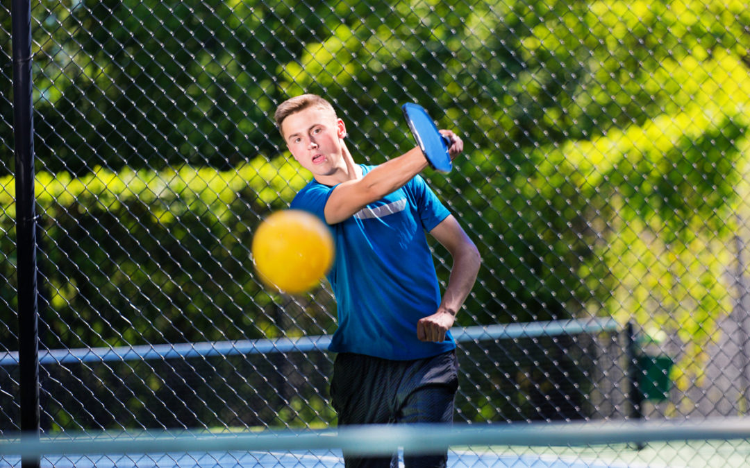 Young Man Pickleball Player Playing Pickleball in Court