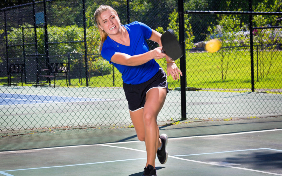 Woman Pickleball Player Playing Pickleball in Court